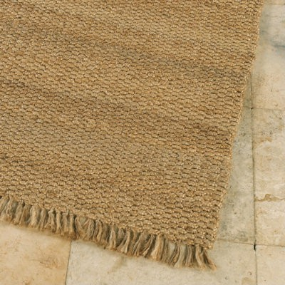 The first is a more casual jute rug ...